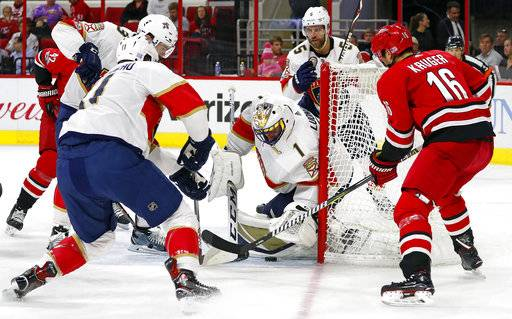 Carolina Hurricanes' Marcus Kruger (16) has his shot blocked by Florida Panthers goalie Roberto Luongo (1) during the second period of an NHL hockey game, Tuesday, Nov. 7, 2017, in Raleigh, N.C.