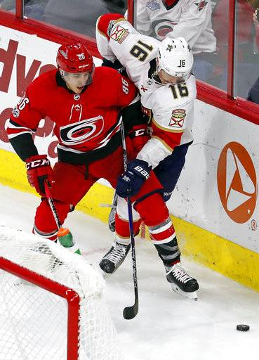 Carolina Hurricanes' Teuvo Teravainen (86) tangles with Florida Panthers' Aleksander Barkov (16) during the third period of an NHL hockey game, Tuesday, Nov. 7, 2017, in Raleigh, N.C.