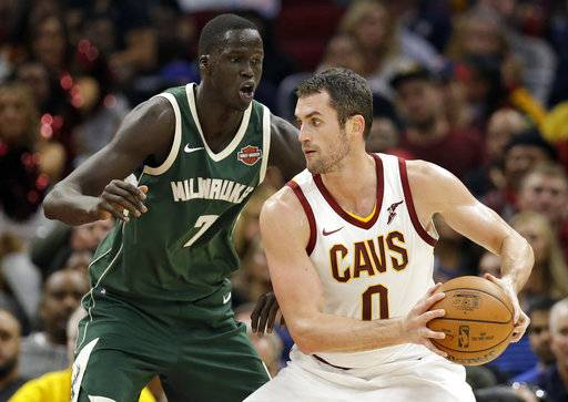 Cleveland Cavaliers' Kevin Love (0) drives against Milwaukee Bucks' Thon Maker (7), from Australia, in the second half of an NBA basketball game, Tuesday, Nov. 7, 2017, in Cleveland. The Cavaliers won 124-119. (AP Photo/Tony Dejak)