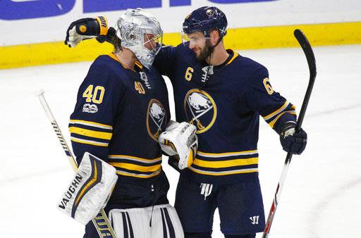 Buffalo Sabres goalie Robin Lehner (40) and defenseman Marco Scandella (6) celebrate a victory over the Washington Capitals after an NHL hockey game, Tuesday Nov. 7, 2017, in Buffalo, N.Y.