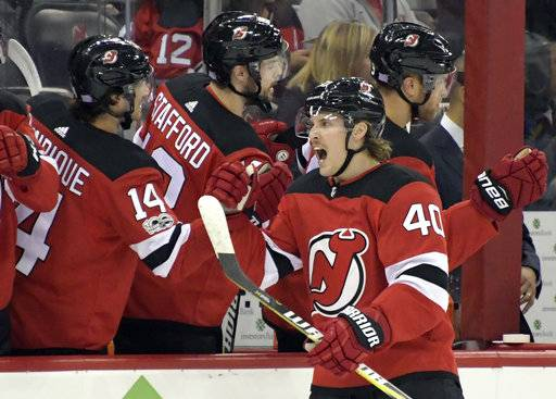 New Jersey Devils center Blake Coleman (40) celebrates after scoring a goal during the first period of an NHL hockey game against the St. Louis Blues on  Tuesday, Nov. 7, 2017, in Newark, N.J. (AP Photo/Bill Kostroun