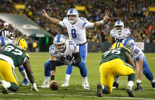 Detroit Lions quarterback Matthew Stafford calls a play during the second half of an NFL football game against the Green Bay Packers Monday, Nov. 6, 2017, in Green Bay, Wis. (AP Photo/Mike Roemer)