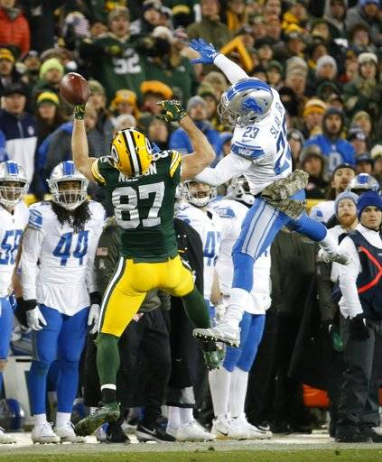 Detroit Lions' Darius Slay breaks up a pass intended for Green Bay Packers' Jordy Nelson during the second half of an NFL football game Monday, Nov. 6, 2017, in Green Bay, Wis.