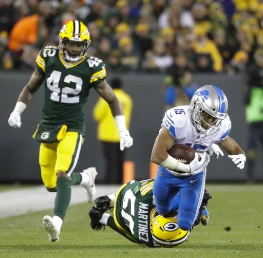 Detroit Lions' Golden Tate is tackled by Green Bay Packers' Blake Martinez after a catch during the second half of an NFL football game Monday, Nov. 6, 2017, in Green Bay, Wis.