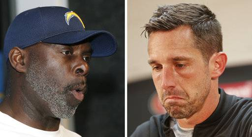 FILE - At left, in an Oct. 29, 2017, file photo, Los Angeles Chargers head coach Anthony Lynn speaks to the media following an NFL football game against the New England Patriots, in Foxborough, Mass. At right, in an Oct. 15, 2017, file photo, San Francisco 49ers head coach Kyle Shanahan pauses as he speaks to members of the media following an NFL football game against the Washington Redskins, in Landover, Md. Lynn's Chargers (3-5) are on the rise after rebounding from a winless first month that included three losses by a field goal or less. While the 49ers are an NFL-worst 0-9, Kyle Shanahan could end up being the biggest winner of all with his team jockeying for the top pick in next year's draft.