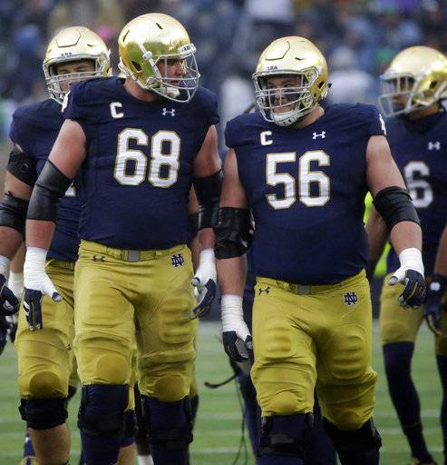 Notre Dame offensive line Mike McGlinchey (68) talks with offensive line Quentin Nelson (56) during the first half of an NCAA college football game against Wake Forest, Saturday, Nov. 4, 2017, in South Bend, Ind.