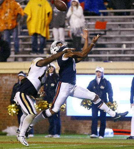 Virginia's Andre Levrone (14) catches a touchdown reception over Georgia Tech's Lance Austin (17) during the second half of an NCAA college football game Saturday, Nov. 4, 2017, in Charlottesville, Va. The go-ahead score was be the game winning play for Virginia. (AP Photo/Zack Wajsgras)