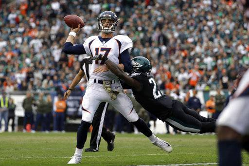 Denver Broncos' Brock Osweiler (17) is tackled by Philadelphia Eagles' Malcolm Jenkins during the second half of an NFL football game, Sunday, Nov. 5, 2017, in Philadelphia.