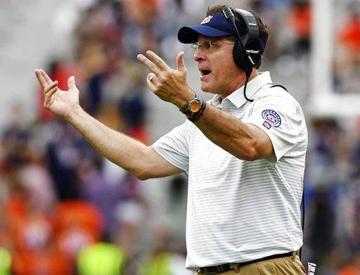 FILE - In this Oct. 7, 2017, file photo, Auburn head coach Gus Malzahn calls to players during the second half of an NCAA college football game against Mississippi in Auburn, Ala. No. 16 Auburn returns from an open date hoping to avoid another SEC West letdown on the road. The Tigers, who blew a 20-point lead earlier at LSU, are set to visit Texas A&M.