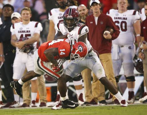 Georgia defensive back Malkom Parrish (14) intercepts a pass intended for South Carolina wide receiver Bryan Edwards (89) during the second half of an NCAA college football game Saturday, Nov. 4, 2017, in Athens, Ga. Georgia won 24-10. (AP Photo/John Bazemore)