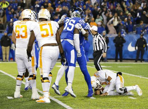 FILE - In this Oct. 28, 2017, file photo, Kentucky defensive end Denzil Ware (35) celebrates after sacking Tennessee quarterback Jarrett Guarantano in an NCAA college football game in Lexington, Ky. Kentucky won the game 29-26. Tennessee entered the season believing the depth of its offensive line was one of its biggest strengths. It hasn't worked out that way. (AP Photo/David Stephenson, File)