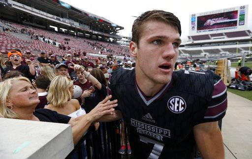 Mississippi State quarterback Nick Fitzgerald (7) leaves fans following an NCAA college football game against Massachusetts in Starkville, Miss., Saturday, Nov. 4, 2017. No. 21 Mississippi State won 34-23. (AP Photo/Rogelio V. Solis)