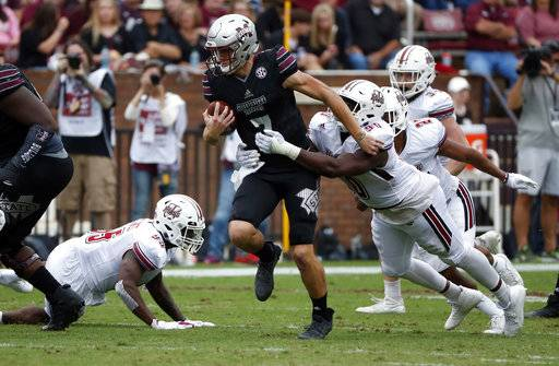 Mississippi State quarterback Nick Fitzgerald (7) is heavily defended by Massachusetts during the first half of an NCAA college football game in Starkville, Miss., Saturday, Nov. 4, 2017.