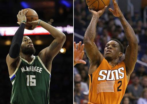 FILE - At left, in a March 6, 2017, file photo, Milwaukee Bucks' Greg Monroe (15) shoots during an NBA basketball game against the Philadelphia 76ers, in Philadelphia. At right, in a March 12, 2017, file photo, Phoenix Suns guard Eric Bledsoe (2) shoots over a Portland Trail Blazers defender during an NBA basketball game, in Phoenix. A person with knowledge of the deal says the Phoenix Suns have agreed to trade disgruntled guard Eric Bledsoe to the Milwaukee Bucks for big man Greg Monroe and two 2018 draft picks. The deal includes a protected first-round and a protected second-round draft pick, according to the person who spoke Tuesday, Nov. 7, 2017,  on condition of anonymity because the trade first reported by ESPN had not yet been finalized.
