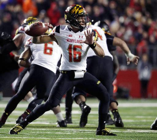 FILE - In this Nov. 4, 2017, file photo, Maryland quarterback Ryan Brand throws a pass against Rutgers during the second half of an NCAA college football game, in Piscataway, N.J. The quarterback carousel at Maryland keeps spinning, with sophomore Ryan Brand in line to be the fourth different starter Saturday against No. 21 Michigan if injured Max Bortenschlager can't go.