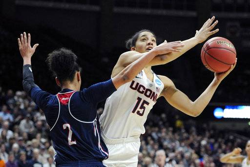 FILE - In this March 21, 2016, file photo, Connecticut's Gabby Williams, right, shoots against Duquesne's Deva'Nyar Workman (2) during the first half of a second round of a women's college basketball game in the NCAA Tournament in Storrs, Conn. Williams was selected to The Associated Press preseason All-America team on Tuesday, Nov. 7, 2017.
