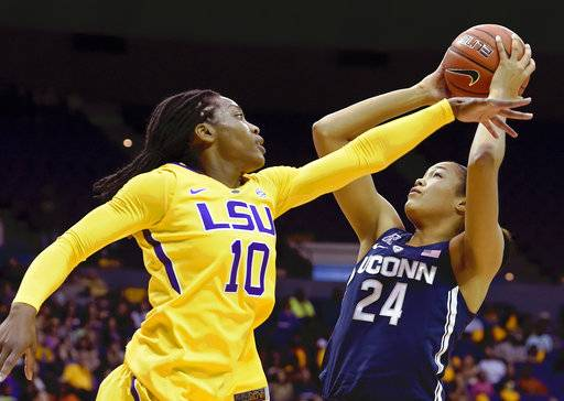 FILE - In this Nov. 20, 2016, file photo, Connecticut forward Napheesa Collier (24) shoots past the outstretched arm of LSU guard Jasmine Rhodes (10) in the second half of an NCAA college basketball game in Baton Rouge, La. Collier was selected to The Associated Press preseason All-America team on Tuesday, Nov. 7, 2017.