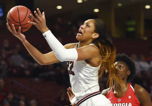 FILE - In this March 3, 2017, file photo, South Carolina forward A'ja Wilson (22) looks to shoot as Georgia forward Caliya Robinson defends in the first half of an NCAA college basketball game during the Southeastern Conference tournament in Greenville, S.C. Wilson was selected to The Associated Press preseason All-America team on Tuesday, Nov. 7, 2017.