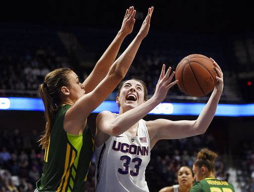 FILE - In this March 6, 2017, file photo, Connecticut's Katie Lou Samuelson (33) shoots over South Florida's Ariadna Pujol during the first half of an NCAA college basketball game in the American Athletic Conference tournament finals in Uncasville, Conn. Samuelson was selected to The Associated Press preseason All-America team on Tuesday, Nov. 7, 2017.