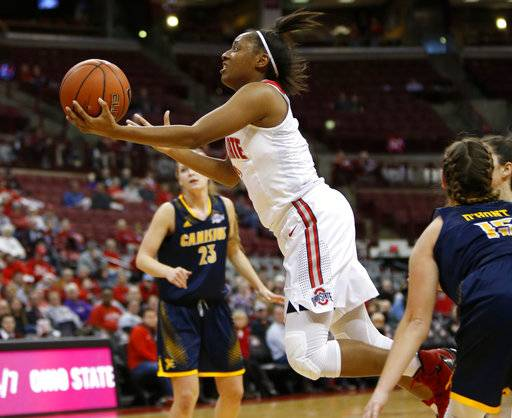 FILE - In this photo taken Dec. 11, 2016, Ohio State guard Kelsey Mitchell, center, goes up to shoot between Canisius forward Sarah Cooley, left, and guard Lauren D'Hont during the first half of an NCAA college basketball game in Columbus, Ohio. Nitchell was selected to The Associated Press preseason All-America team on Tuesday, Nov. 7, 2017.