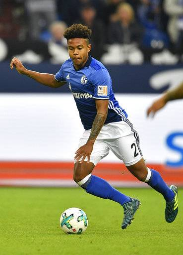 FILE - In this Sept. 10, 2017, file photo, Schalke's Weston McKennie runs for the ball during the German Bundesliga soccer match against VFB Stuttgart at the Arena in Gelsenkirchen, Germany. McKennie could make his U.S. national team debuts in a Nov. 14 exhibition at Portugal. (AP Photo/Martin Meissner, File)