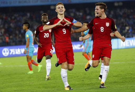 FILE - In this Oct. 6, 2017, file photo, U.S. soccer player Josh Sargent (9) celebrates a goal against India during their FIFA U-17 World Cup match in New Delhi, India. Sargent could make his U.S. national team debuts in a Nov. 14 exhibition at Portugal.