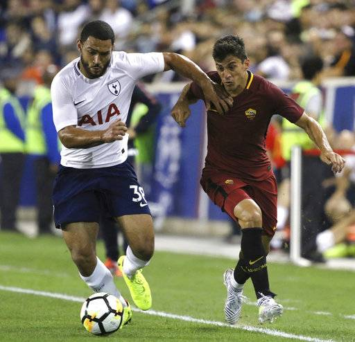 FILE - In this July 25, 2017, file photo, Tottenham Hotspur's Cameron Carter-Vickers, left, and AS Roma's Diego Perotti fight for the ball during their 2017 International Champions Cup match, in Harrison, N.J. Carter-Vickers could make his U.S. national team debuts in a Nov. 14 exhibition at Portugal.