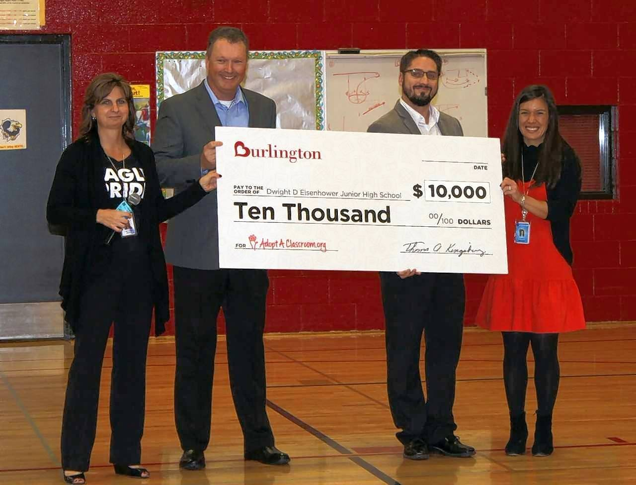 Officials from Burlington Stores recently presented a check for $10,000 to Eisenhower Junior High School in Hoffman Estates. From left, Eisenhower Principal Heather Wilson, Burlington Regional Vice President Tom Floore, Hoffman Estates store manager Dan Hoss and Eisenhower Assistant Principal Amy Houlihan.