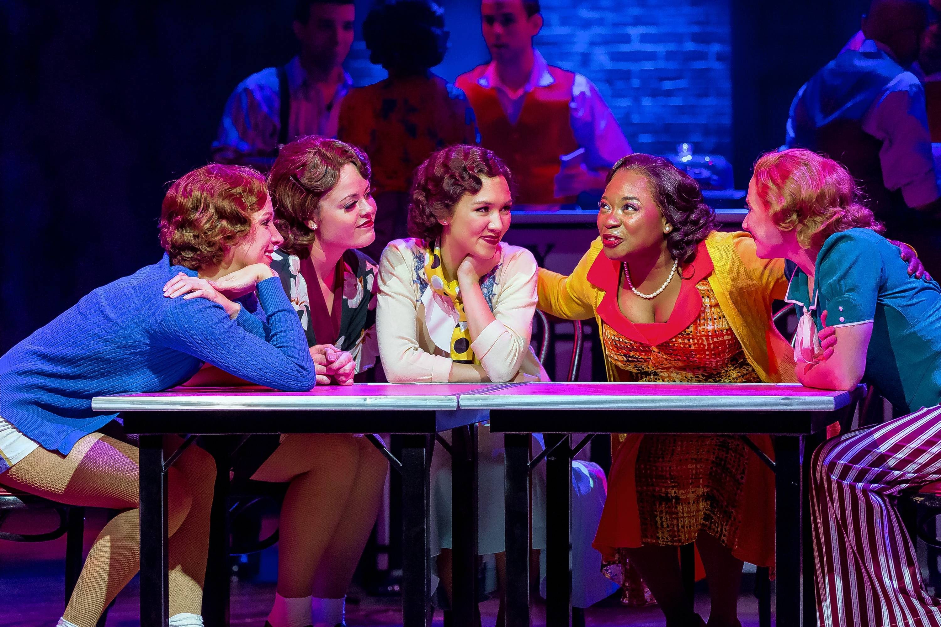 "Songwriter Maggie Jones (Donica Lynn), second from right, sings the pep talk ""Go Into Your Dance"" to aspiring actress Peggy Sawyer (Kimberly Immanuel), center, as the employed chorines Lorraine (Mandy Modic), left, Annie (Sierra Schnack) and Phyllis (Annie Jo Ermel), right, listen in ""42nd Street"" at Drury Lane Theatre."