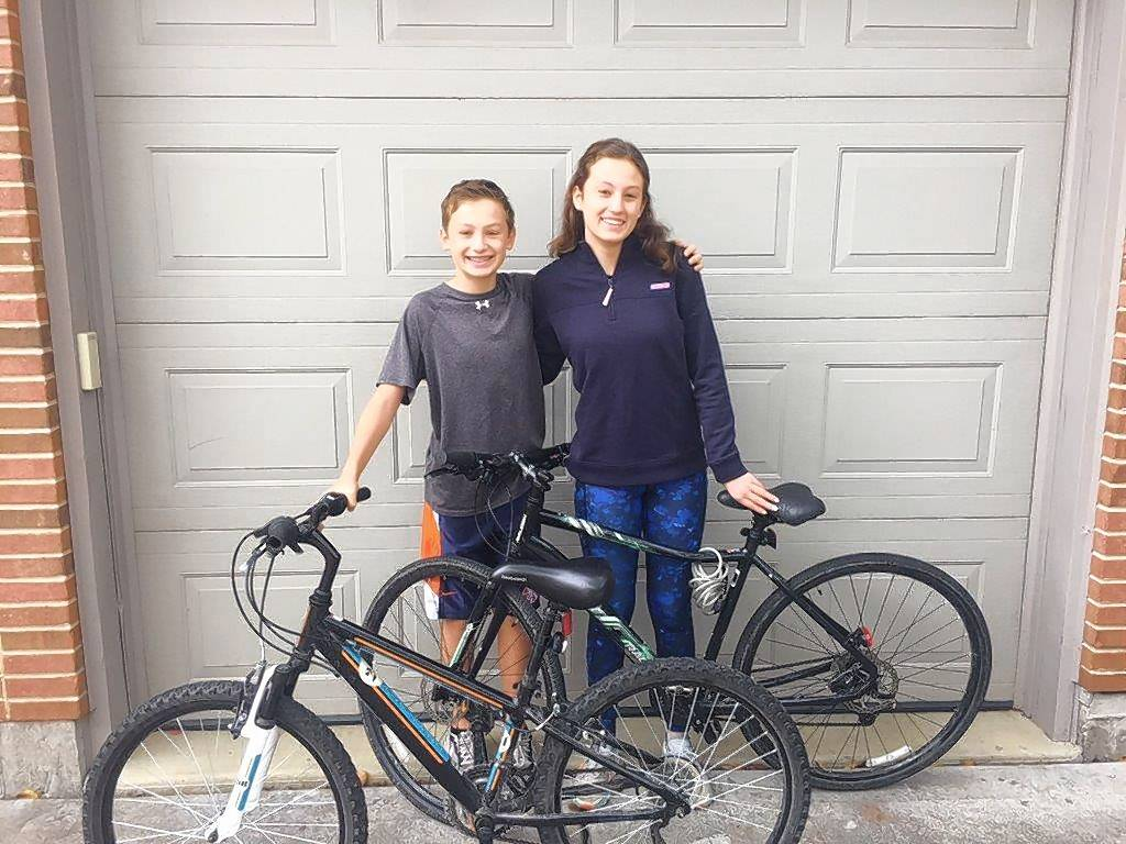 Grant and Lauren Schleiter of Elmhurst will collect used bicycles Saturday, Nov. 11, that will be donated to high-achieving students in need at a Chicago school.