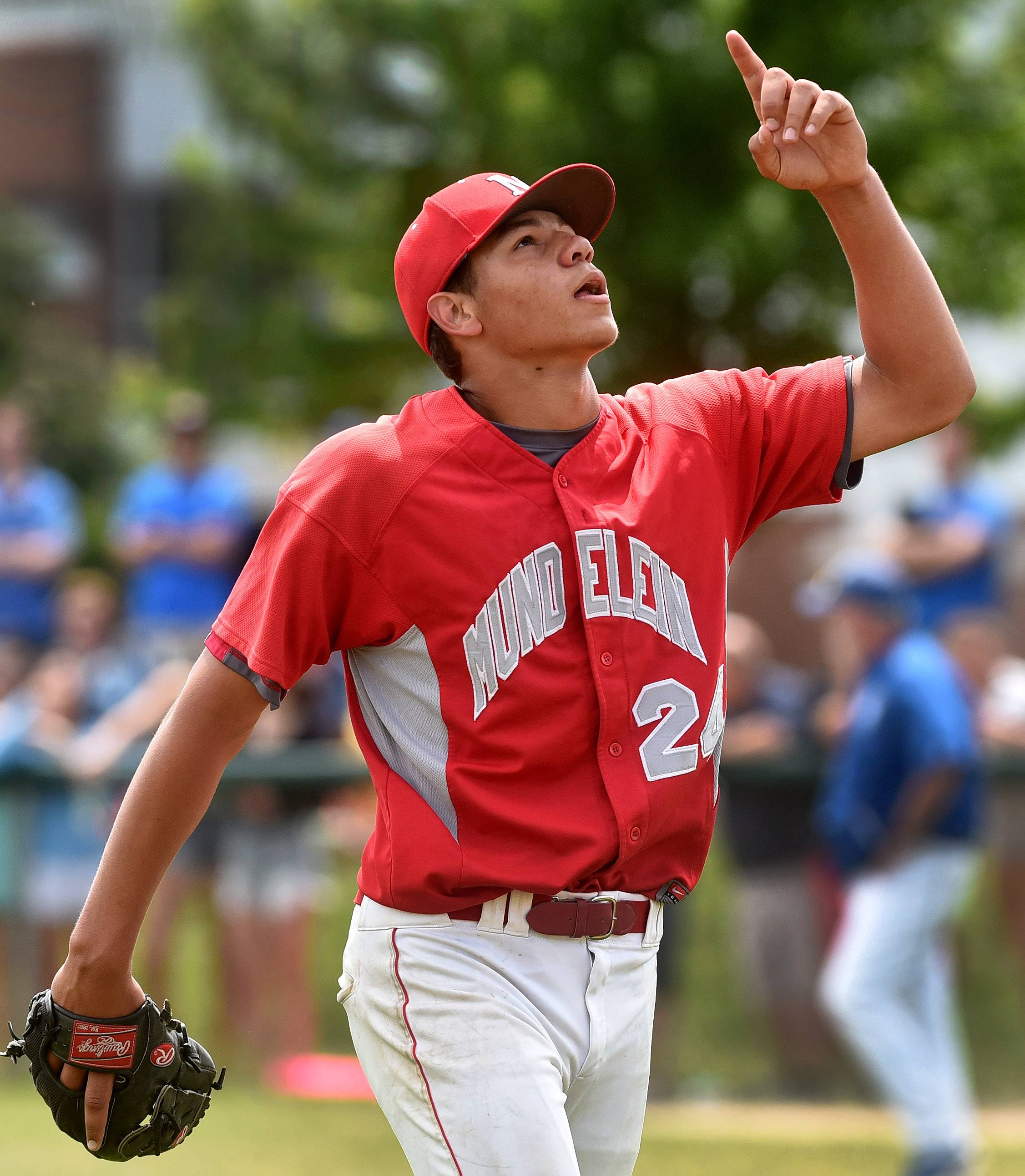 Steven Sanchez points to the sky and leaves the game after pitching no-hit ball during Class 4A Glenbrook South sectional final between Mundelein and Warren.