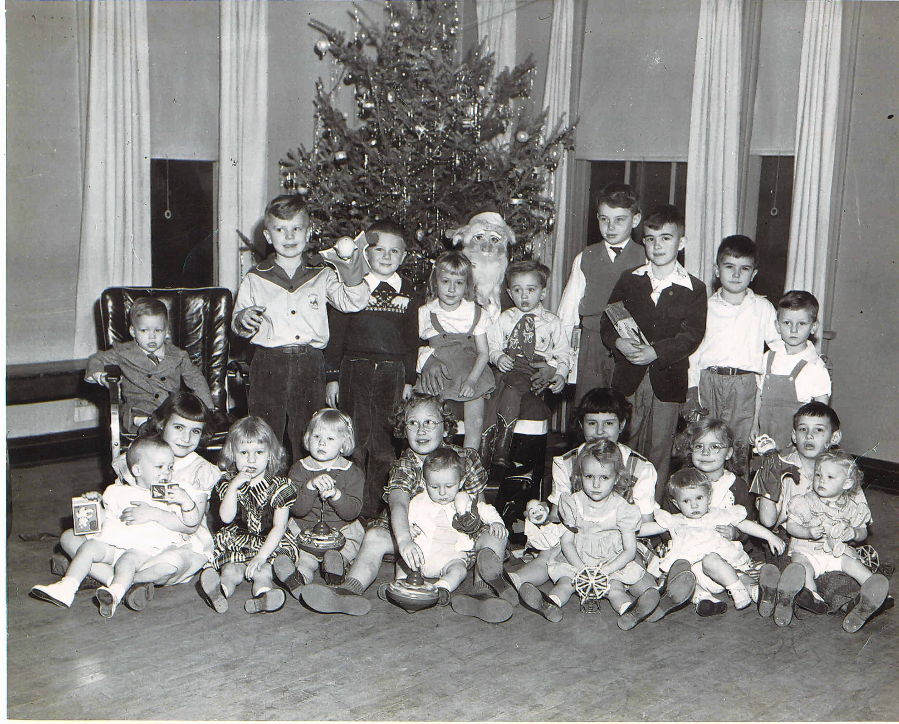 Children enjoy a Christmas party at the Veterans of Foreign War hall in Mount Prospect.