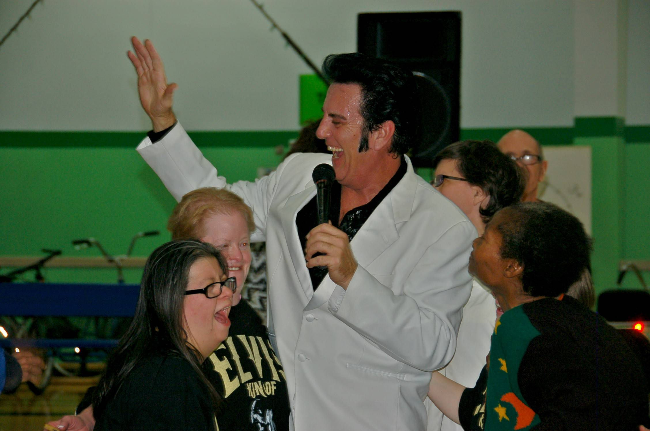 Elvis club members sing along with tribute artist Travis Morris in celebration.Marisa LaBello