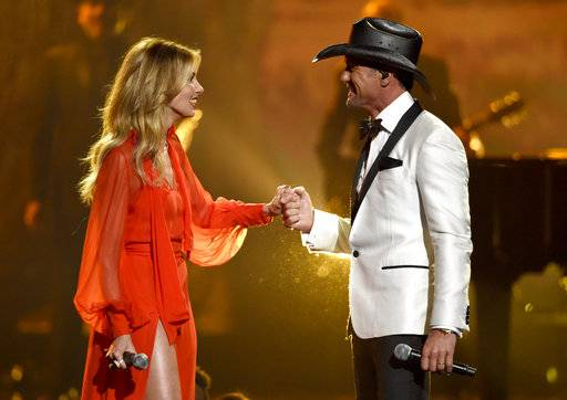 "Faith Hill, left, and Tim McGraw perform ""The Rest of Our Life"" at the 51st annual CMA Awards at the Bridgestone Arena on Wednesday, Nov. 8, 2017, in Nashville, Tenn. (Photo by Chris Pizzello/Invision/AP)"