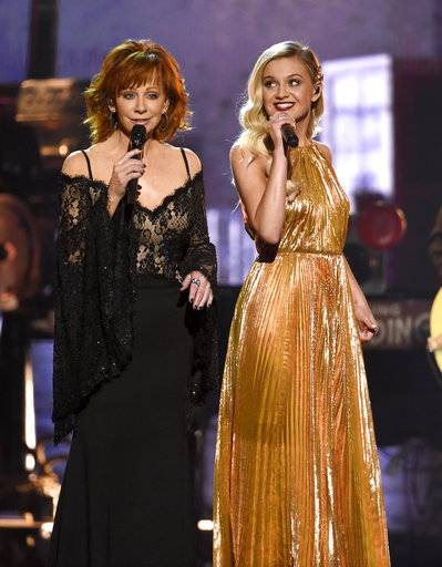 "Reba McEntire, left, and Kelsea Ballerini perform ""Legends"" at the 51st annual CMA Awards at the Bridgestone Arena on Wednesday, Nov. 8, 2017, in Nashville, Tenn. (Photo by Chris Pizzello/Invision/AP)"