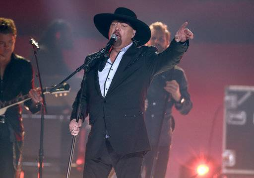 "Eddie Montgomery performs ""My Town"" at the 51st annual CMA Awards at the Bridgestone Arena on Wednesday, Nov. 8, 2017, in Nashville, Tenn. (Photo by Chris Pizzello/Invision/AP)"