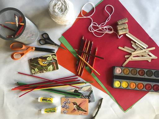 This Oct. 6, 2017 photo provided by Katie Workman shows Thanksgiving craft table supplies in New York. (Katie Workman via AP)