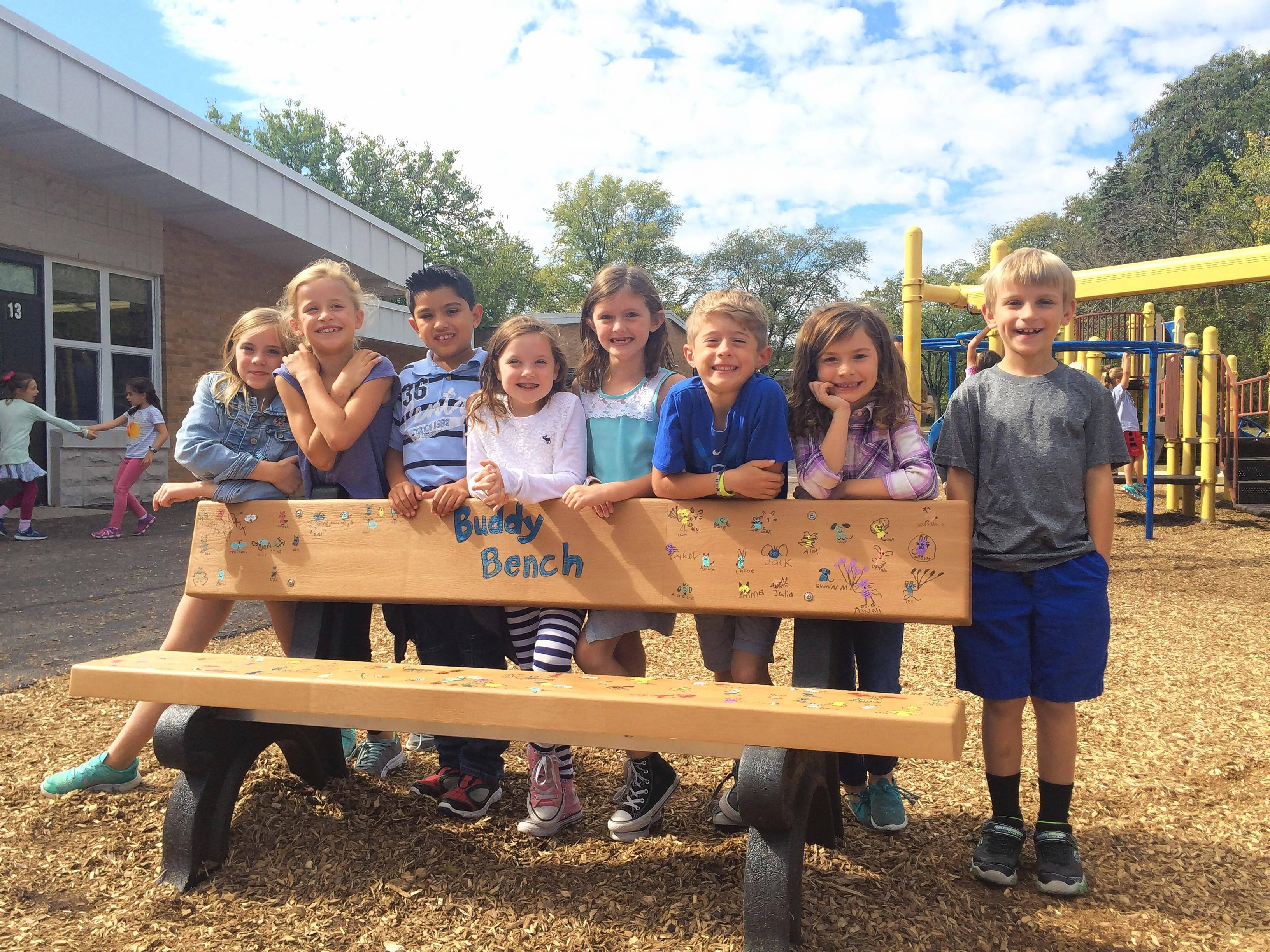 Abraham Lincoln School students Olivia Davis, Chloe Todd, Dominic Moyano, Evelyn Dieter, Quinn Luttenton, Charlie Luttenton, Elle Miller and Cooper Ksiazek helped raise funds to install a buddy bench at the campus playground. If kids are feeling lonely and sit on the bench, their peers invite them to play.
