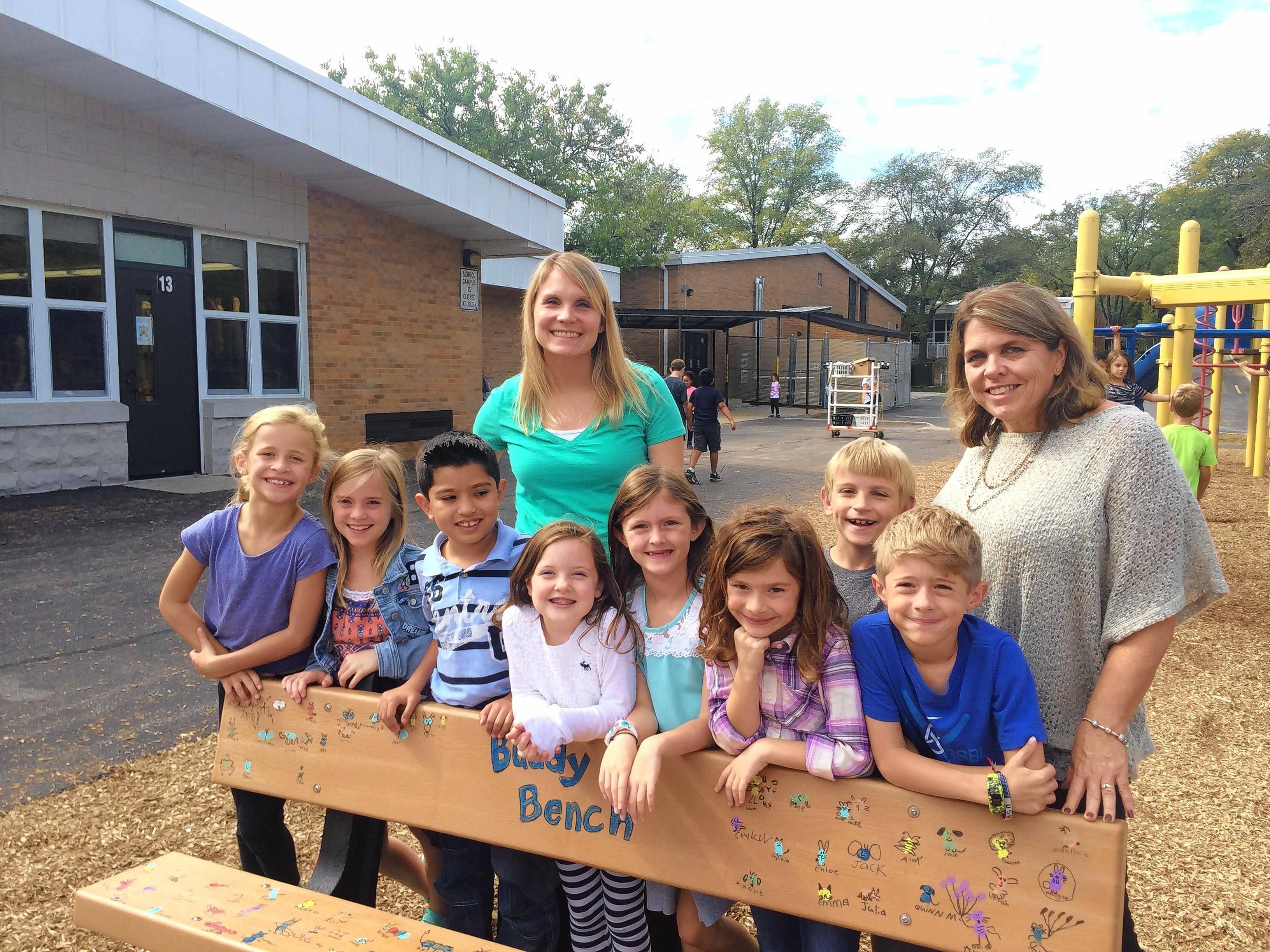 First-grade teachers Christine Kotarba and Patty Dentinger, right, said students who are now second-graders took ownership of a yearlong project to bring the buddy bench to Abraham Lincoln School.