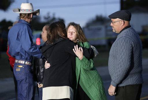 Second Lady Karen Pence, center, hugs Sherri Pomeroy as her husband, Pastor Frank Pomeroy, stands at right, outside the Sutherland Spring Baptist Church during a stop, Wednesday, Nov. 8, 2017, in Sutherland Springs, Texas. A man opened fire inside the church in the small South Texas community on Sunday, killing and wounding many.