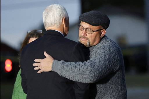 Vice President Mike Pence hugs Pastor Frank Pomeroy outside the Sutherland Spring Baptist Church during a stop, Wednesday, Nov. 8, 2017, in Sutherland Springs, Texas. A man opened fire inside the church in the small South Texas community on Sunday, killing and wounding many. Pomeroy's daughter was killed in the shooting.