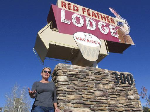 In this Tuesday, oct. 31, 2017 photo, Clarinda Vail stands outside the lodge her family owns in Tusayan, Ariz.. Vail opposes a ballot measure to increase building heights in the small town outside the Grand Canyon's South Rim entrance.