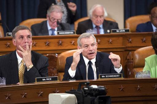 Rep. David Schweikert, R-Ariz., joined at left by Rep. Tom Rice, R-S.C., makes a point as the House Ways and Means Committee continues its debate over the Republican tax reform package, on Capitol Hill in Washington, Wednesday, Nov. 8, 2017.