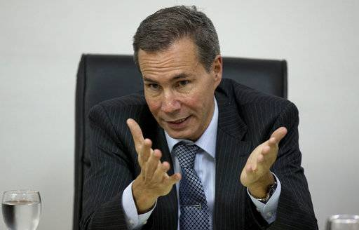 FILE - In this May 29, 2013, file photo, Alberto Nisman, the prosecutor investigating the 1994 bombing of the Argentine-Israeli Mutual Association community center, talks to journalists in Buenos Aires, Argentina. An investigation by border police has concluded in 2017 that Nisman, the man who led the probe was murdered just days after accusing then-President Cristina Fernandez of covering up the role of Iranian officials in the 1994 bombing that killed 85 at a Jewish center.