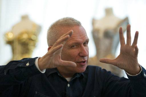 "French designer Jean Paul Gaultier attends an interview with the Associated Press in Paris, France, Wednesday, Nov. 8, 2017. The 65-year-old French couturier announced that a racy, music-filled ""show"" with all the corsets, sparkle and provocation is in the works for October 2018, retelling his colorful life. (AP Photo/Francois Mori),"