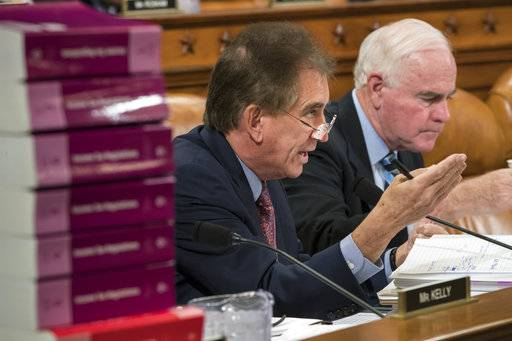 Rep. Jim Renacci, R-Ohio, joined at right by Rep. Pat Meehan, R-Pa., makes a point as the House Ways and Means Committee continues its debate over the Republican tax reform package, on Capitol Hill in Washington, Wednesday, Nov. 8, 2017.