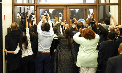 People rush the doors of the jury assembly room as former President Barack Obama departs after being dismissed from jury duty in the Daley Center on Wednesday, Nov. 8, 2017, in Chicago. For his time served, Obama is in line to be paid $17.20.
