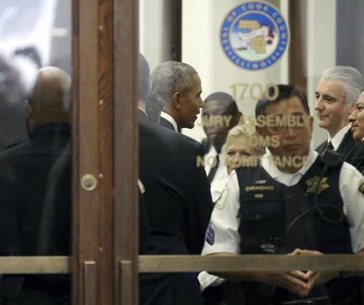 Former President Barack Obama arrives for jury duty in the Daley Center on Wednesday, Nov. 8, 2017, in Chicago. Obama is in line to be paid the same $17.20 a day that others receive for reporting for jury duty. (Kevin Tanaka/Sun Times via AP)