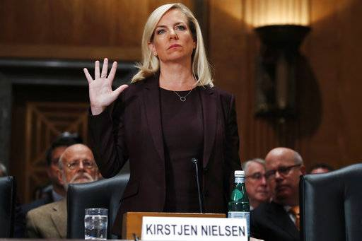 Kirstjen Nielsen is sworn in at a hearing on her nomination to be Department of Homeland Security Secretary, by the Senate Homeland Security and Governmental Affairs committee, Wednesday, Nov. 8, 2017, on Capitol Hill in Washington.