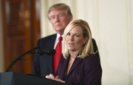 FILE - In this Oct. 12, 2017, file photo, President Donald Trump, left, listens as Kirstjen Nielsen, right, a cybersecurity expert and deputy White House chief of staff, speaks in the East Room of the White House in Washington after Trump announced that she is his choice to be the next Homeland Security Secretary. Nielsen was tapped to help shepherd Trump's Department of Homeland Security secretary pick through his Senate confirmation process. Now she's got her own team shepherding her. The Senate Homeland Security Committee will hold a confirmation hearing for Nielsen on Wednesday, Nov. 8.